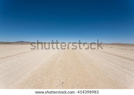 Dirt road out from Sesriem to Swakopmund, Namib desert, Namibia #414398983