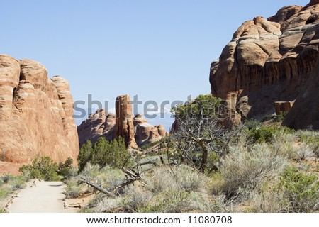 dirt road to Devils Garden on Arches National Park with mountains on back, Utah, USA
