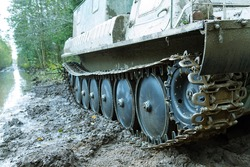 Dirty all-terrain vehicle tracks, caterpillar truck after working in swampy terrain