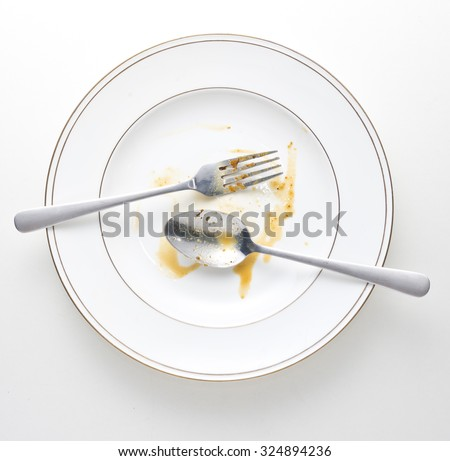 dirty and empty dishes with spoon and fork. #324894236
