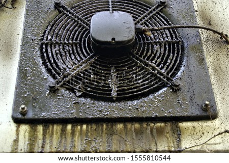 Dirty and greasy grime on outside wall ventilation #1555810544