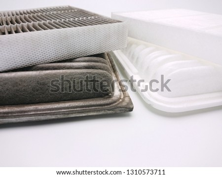 Dirty and new automotive cabin, engine air filter isolated on white background #1310573711