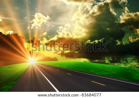 Dirty asphalt road and dark thunder clouds - stock photo