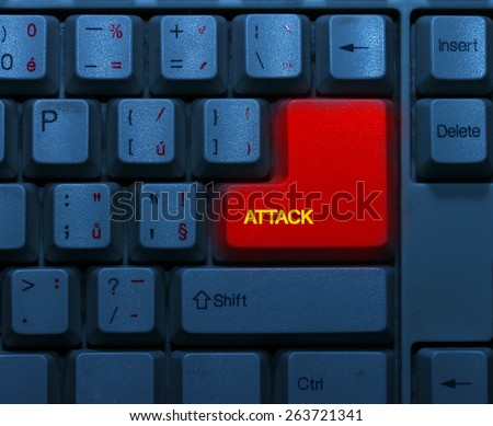 Dirty blue keyboard with red notice Attack. Terrorism online concept.