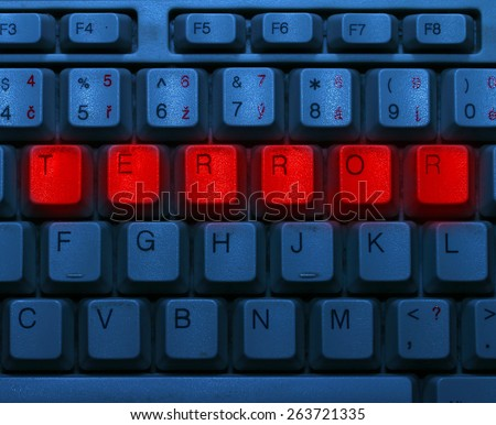 Dirty blue keyboard with red notice Terror. Terrorism online concept.
