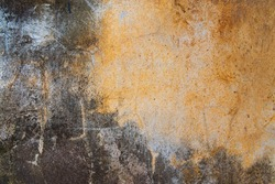 Dirty concrete walls with mold and rust stains.