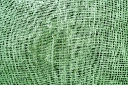 Dirty cotton canvas pattern in green tone. abstract background and texture