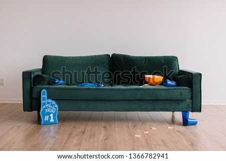 dirty couch after sports tv watching party #1366782941