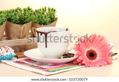 dirty cup of coffee and gerbera  beans, cinnamon sticks on wooden table