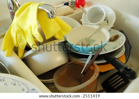 Dirty dishes with rubber cleaning gloves