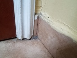 dirty filthy corner in bathroom with dust and grime