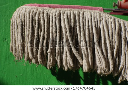 dirty floor cleaning fibers.  green wall background. ストックフォト ©