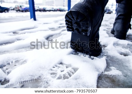 Dirty footprints in the snow in the winter.  #793570507