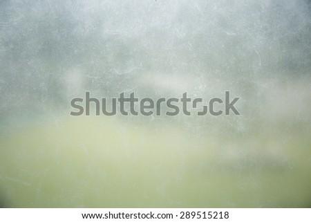 Dirty glass in garden background