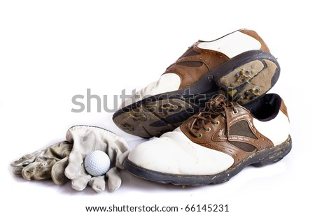 Dirty golf shoes and acessories isolated on white