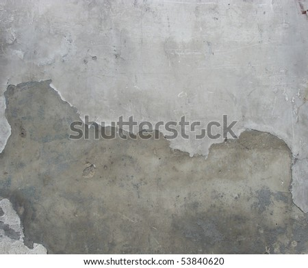 dirty gray worn cement wall with a section plastered