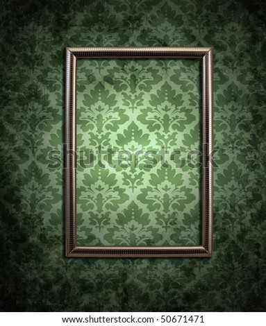 dirty green wallpaper and an empty frame