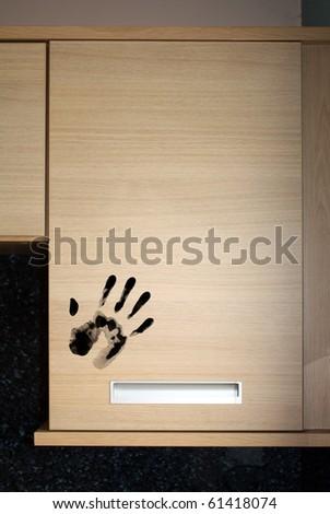 dirty hand print on food cupboard door