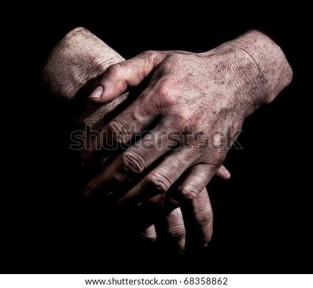 Dirty Hands - Dirty male hands against black background