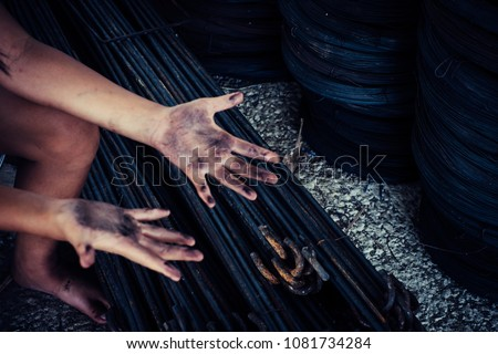 Dirty hands of children from construction work. World Day Against Child Labour concept.