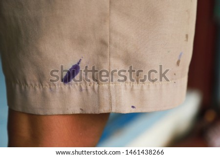 Dirty ink and mud stain on clothes from unexpected accident in daily life. dirt stains for cleaning and washing concept #1461438266