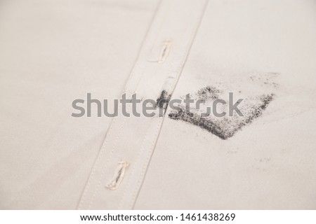 Dirty ink and mud stain on clothes from unexpected accident in daily life. dirt stains for cleaning and washing concept #1461438269
