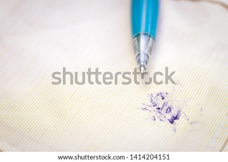 Dirty ink pen stain on fabric from accident in daily life. dirt stains for cleaning work house  #1414204151