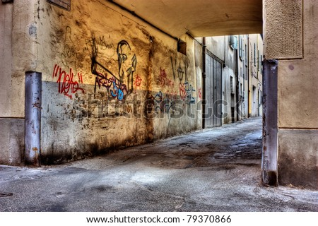 dirty lane in the old town, corner of narrow street, grunge wall with graffiti, draw of smoker of hashish, old passage with drawing of cannabis, drug addiction marijuana joint marijuana reefer spliff