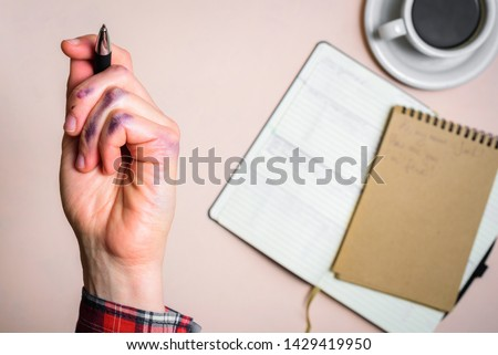 Dirty left hand after writing. Left hander day concept. Working place of lefty #1429419950