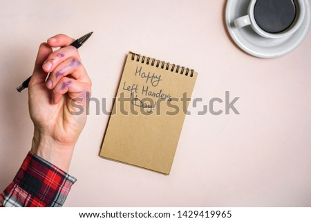 Dirty left hand after writing. Left hander day concept. Working place of lefty #1429419965
