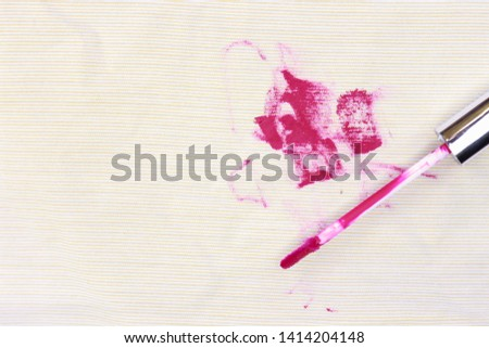 Dirty lipstick and cosmetic stain on fabric from accident in daily life. dirt stains for cleaning work house  #1414204148