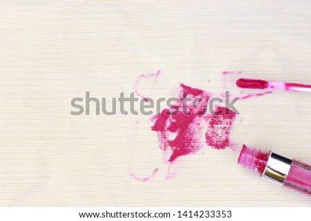Dirty lipstick and cosmetic stain on fabric from accident in daily life. dirt stains for cleaning work house  #1414233353