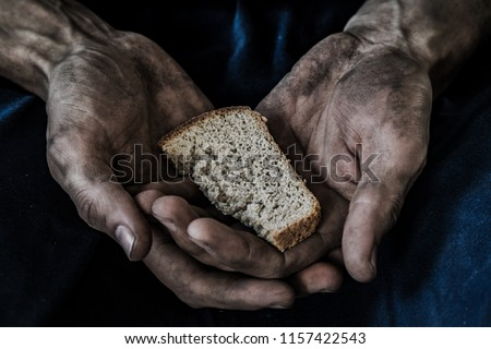 dirty male hands with a piece of bread, poverty, hunger Сток-фото ©