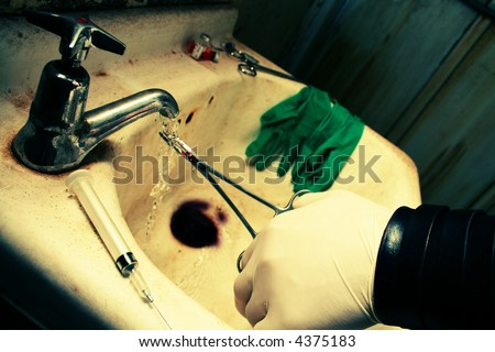 Dirty medical scene. Concept for drug abuse, illegal medical rocedures, organ trafficing or fear of surgery - stock photo