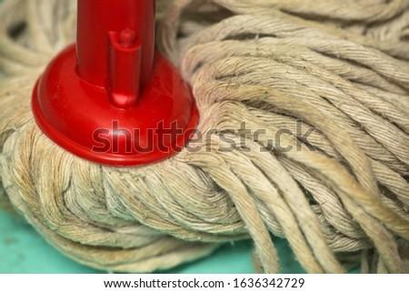 Dirty mop on dirty floor
