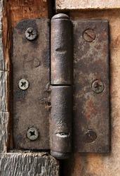 dirty old rusty door hinge