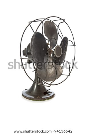 Dirty old vintage metal fan isolated on white