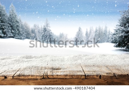 dirty old wooden table place of snow and trees of snow place  #490187404