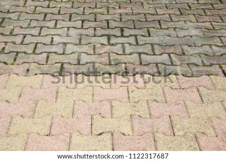 Dirty pavement with dense moss requiring cleaning before and after #1122317687
