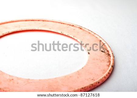 Dirty pink dog frisbee against faded white background