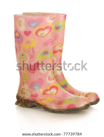 dirty pink rubber boots on white background