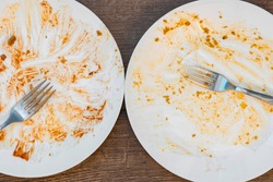 dirty plates after eating. filthy Cutlery. forks on a plate. messy dishes after eating. End of meal. Good appetite, delicious food and dish concept