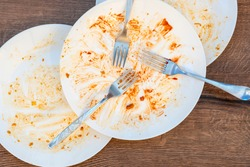 dirty plates, forks, cutlery after eating. Dirty dishes after eating. End of meal. Good appetite, delicious food and dish concept. top view