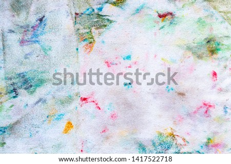 cd858f698fb0ae Dirty rag cloth with colorful of watercolor on texture surface for cleaning  isolate on white.