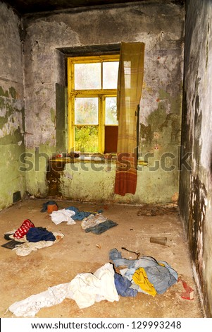 dirty room with tatters in abandoned house