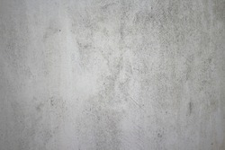 Dirty rough surface texture of sand screed cement wall with uneven stains and tiny holes.