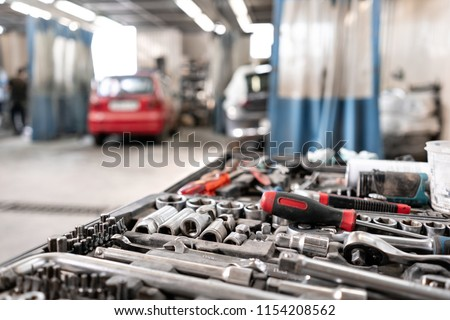 Dirty set of hand tools and wrenchs close-up in box. Garage painting car service. Tool to repair the car or replace automotive spare parts, auto parts. Dirty tool service #1154208562