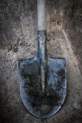 Dirty shovel in fresh soil.