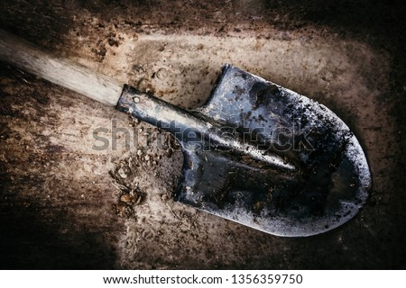 Dirty shovel in fresh soil. Deep hole in the ground. Rusty old tool on construction. Dig deep ditches and pits. Photo stock ©