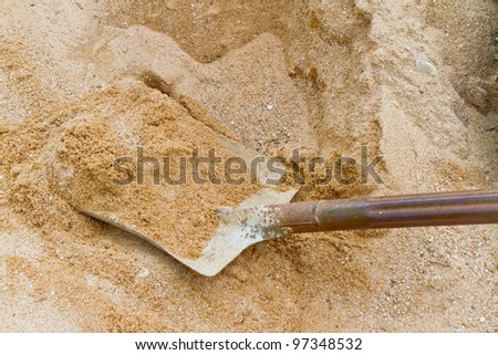 dirty shovel working on sand